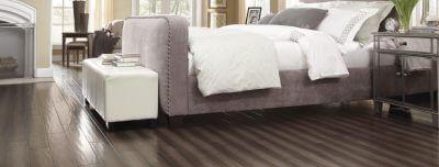 grey-hardwood-bedroom-1050x400